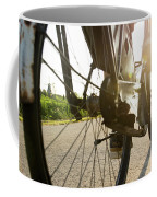 Close Up Of Wheel Of Bicycle On Road Coffee Mug
