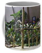 Colorful Macaws And Other Small Birds On Trees At An Exhibit Coffee Mug
