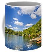 Cottages On Lake With Docks Coffee Mug by Elena Elisseeva