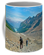 Couple Hiking On Plain Of Six Glaciers Trail  In Banff Np-albert Coffee Mug