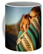 Couple Wraps Themselves In A Blue Coffee Mug