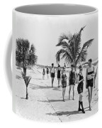 Couples Strolling Along The Pathway On The Beach. Coffee Mug