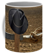 Cowboy Hat And Rope On Fence Coffee Mug by Olivier Le Queinec