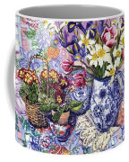 Daffodils Tulips And Iris In A Jacobean Blue And White Jug With Sanderson Fabric And Primroses Coffee Mug