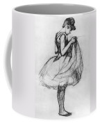 Dancer Adjusting Her Costume And Hitching Up Her Skirt Coffee Mug by Henri de Toulouse-Lautrec