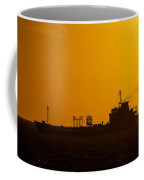 Dark Boat Silhouette At Sunset Coffee Mug