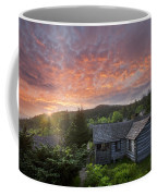 Dawn Over Leconte Coffee Mug by Debra and Dave Vanderlaan