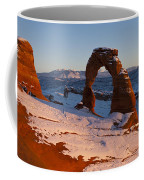 Delicate Arch With Snow At Sunset Arches National Park Utah Coffee Mug