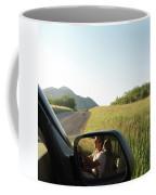Detail Of Man In Side Mirror Of Car Coffee Mug