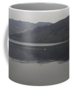 Distant View Of A White Goose Swimming Peacefully In Loch Ness Coffee Mug