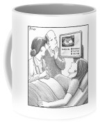 Doctor And Couple Look At Sonogram Which Shows Coffee Mug