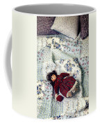 Doll On Bed Coffee Mug