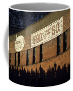 Downtown Seattle With Silhouetted Runners On Brick Wall Early Mo Coffee Mug