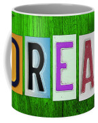 Dream License Plate Letter Vintage Phrase Artwork On Green Coffee Mug by Design Turnpike