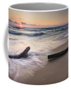 Driftwood On The Beach Coffee Mug by Adam Romanowicz
