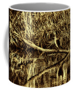 drying cormorant BW- Black bird sitting on log over water Coffee Mug