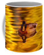 Duck On Golden Water Coffee Mug