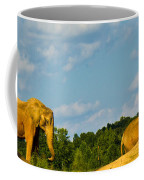 Elephants Among The Rocks. Coffee Mug