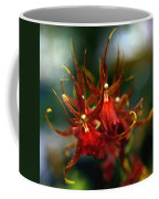 Embraced By An Orchid Coffee Mug by Karen Wiles