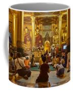 faithful Buddhists praying at Buddha Statues in SHWEDAGON PAGODA Yangon Myanmar Coffee Mug