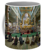 faithful Buddhists praying at sitting Buddha in golden Ponnya Shin Pagoda Coffee Mug