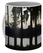 Family Silhouetted By Lake Coffee Mug