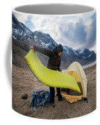 Female Hiker Sets Up Tent On Wild Coffee Mug