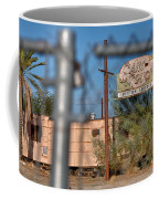 Fenced In  Abandoned 1950's Motel Trailer Coffee Mug