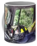 Firemen - Helmet Inside Cab Of Fire Truck Coffee Mug by Susan Savad