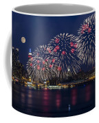 Fireworks And Full Moon Over New York City Coffee Mug by Susan Candelario