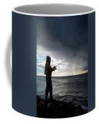 Fisherman Fishing While Storm Blows Coffee Mug