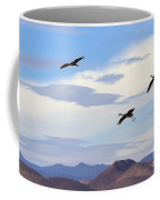 Flight Of The Sandhill Cranes Coffee Mug by Mike  Dawson