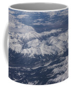 Flying Over The Snow Covered Rocky Mountains Coffee Mug