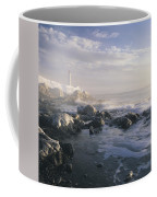 Fog And Rocky Shoreline In Winter With Coffee Mug