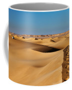 Footprints And 4x4 Offroad Car In Landscape Of Endless Dunes In Sand Desert  Coffee Mug