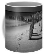 Footprints In The Sand Among The Pilings Coffee Mug