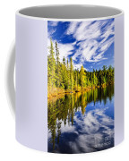 Forest And Sky Reflecting In Lake Coffee Mug