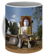 four sitting Buddhas 30 metres high looking in four points of the compass at Kyaikpun Pagoda Coffee Mug