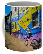 Girl Rides Bicycle Past Mural On The South Side Of Pittsburgh Coffee Mug