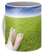 Girls Feet On Grass With Flowers Coffee Mug