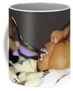 Giving Milk To A 4 Day Old Indian Baby Boy Through A Spoon Coffee Mug