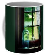Glass Bottles On Windowsill Coffee Mug
