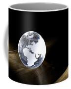Glass Globe On Wooden Floor Coffee Mug