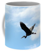 Great Blue Heron Flying Past The Clouds Above Trojan Pond Coffee Mug