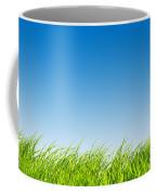 Green Fresh Grass On Blue Sky Panorama. Coffee Mug