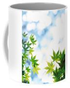 Green Leaves On Mottled Cloudy Sky Coffee Mug
