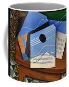 Guitar On A Table Coffee Mug