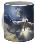 Gull Flying Under A Radiant Sunburst Coffee Mug