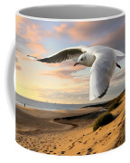 Gull On The Wing Over Beach Landscape Coffee Mug