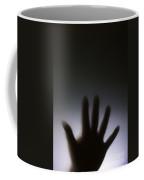 Hand Against A Window Coffee Mug
